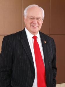 Mr. Gavin M. Faull, Chairman and President of Swiss-Belhotel International
